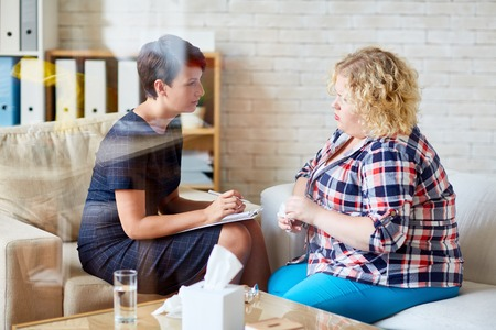 Female with overweight and her psychologist talking about her problem Stock Photo