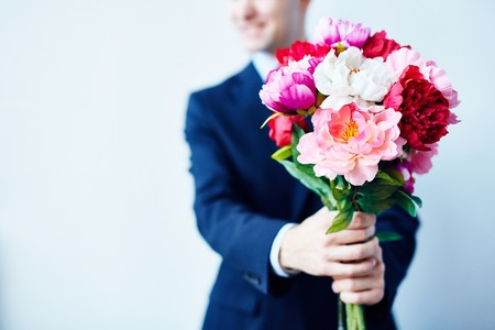 bunch of flowers: Close-up of a splendid bouquet in hands of a man Stock Photo
