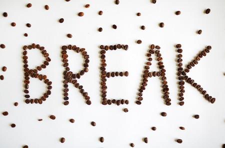 jamoke: Coffee seeds shaping a break word Stock Photo
