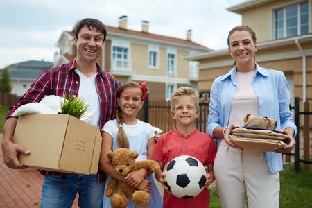 Modern family of four settling or leaving for new house