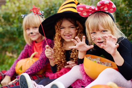 repent: Three girls in Halloween costumes looking at camera