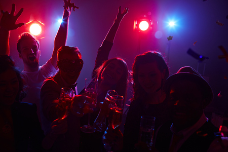 ecstatic: Ecstatic dancers with champagne enjoying party in nightclub