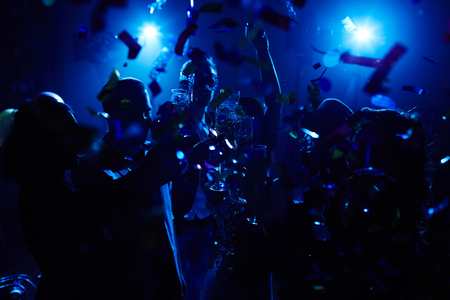 toasting: Large group of clubbers toasting with champagne at party Stock Photo