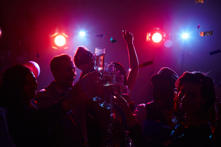 ecstatic: Ecstatic crowd toasting for nice party in night club