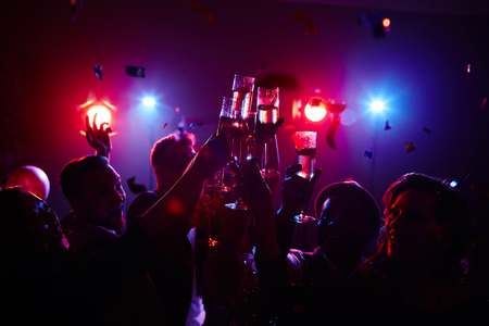 joyous: Joyous friendly people toasting in night club Stock Photo