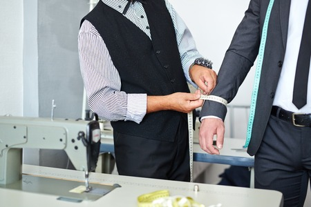 girth: Tailor measuring girth of jacket sleeve