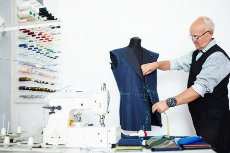 dressmaker: Modern dressmaker trying jacket on mannequin