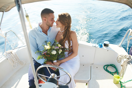 amorous: Amorous bride and groom traveling on yacht during honeymoon