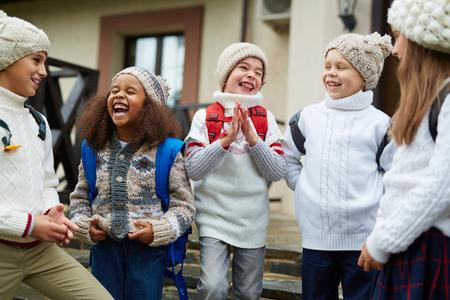 schoolkids: Ecstatic schoolkids spending break between lessons outdoors