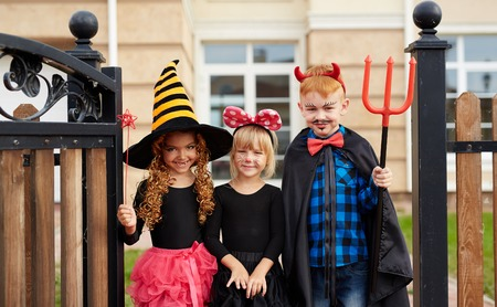 repent: Little kids in Halloween attire looking at camera Stock Photo