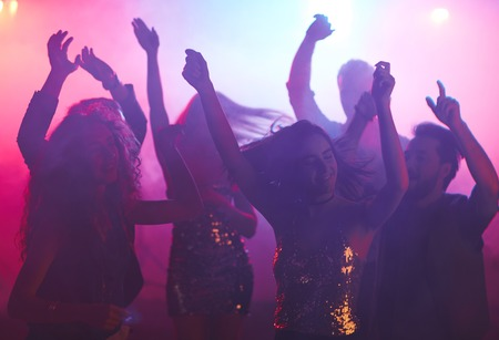 clubber: Group of happy girls and guys dancing at night party Stock Photo