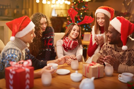 young people celebrating christmas at home stock photo picture and royalty free image image 63745802 - Celebrating Christmas