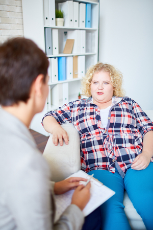 fatness: Fat woman talking to counselor during her visit Stock Photo
