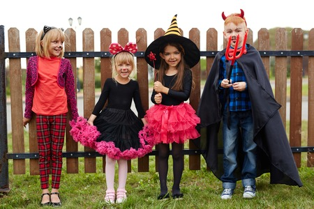 Cute friendly children in Halloween costumes Stock Photo
