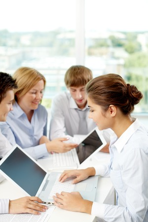 school class: Successful business people sitting at the table and using laptop Stock Photo
