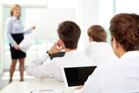 school class: Business people sitting at seminar Stock Photo