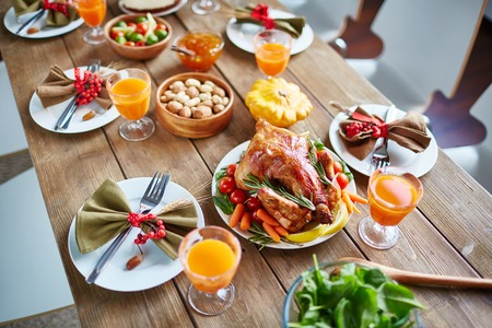 nicely: Appetizing roasted chicken served with vegetables on nicely settled table Stock Photo