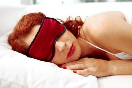 sleep mask: Portrait of young woman sleeping in sleep mask