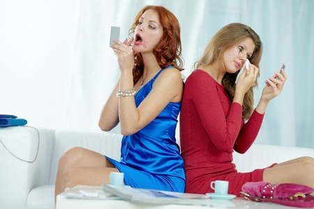 smeared: Two women sprucing after a scene Stock Photo