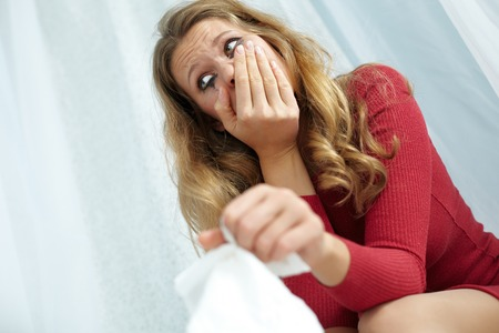 smeared mascara: Portrait of young crying woman