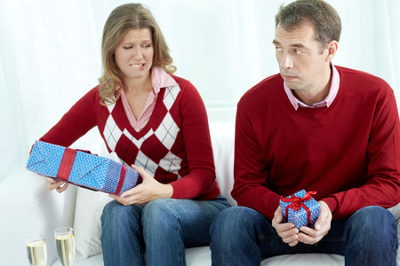 box size: Displeased couple going to exchange gift boxes of different sizes on their special occasion