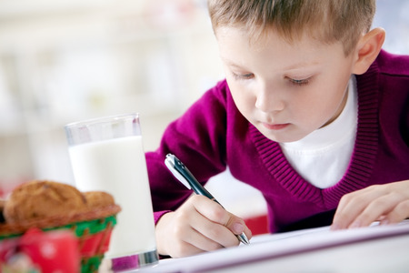 letter writing: Portrait of little boy writing a letter Stock Photo