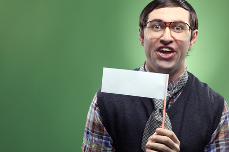 sissy: Portrait of typical nerd holding paper ad. You can add your text here Stock Photo