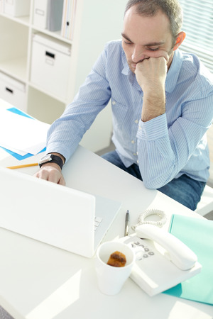 mundane: Above view of businessman bored of work