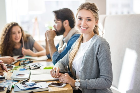Happy young specialist looking at camera during work Stock Photo