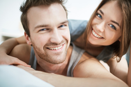 Smiling young couple looking at camera Stock Photo