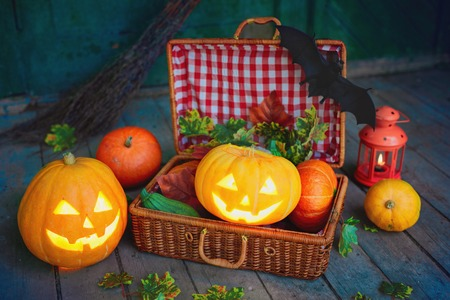 repent: Halloween pumpkins and suitcase with vegs