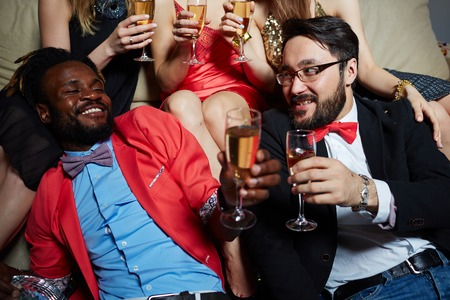 clubber: Two posh guys cheering with champagne at booze Stock Photo