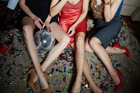 clubber: Legs of three girls sitting on the floor after party