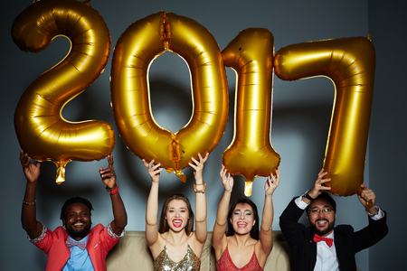 ecstatic: Group of ecstatic friends holding number of the following year