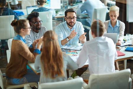 Team of designers or economists discussing ideas in office Archivio Fotografico