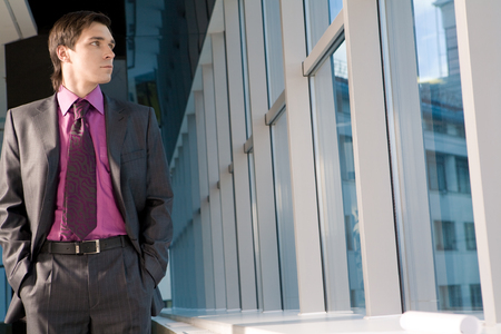 Portrait of businessman looking at window photo