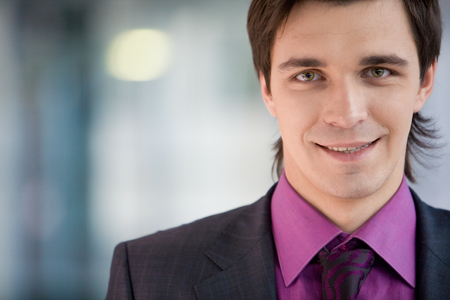 Portrait of young businessman with smile photo