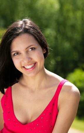 eyes hazel: Portrait of beautiful brunette in pink t-shirt looking at camera Stock Photo