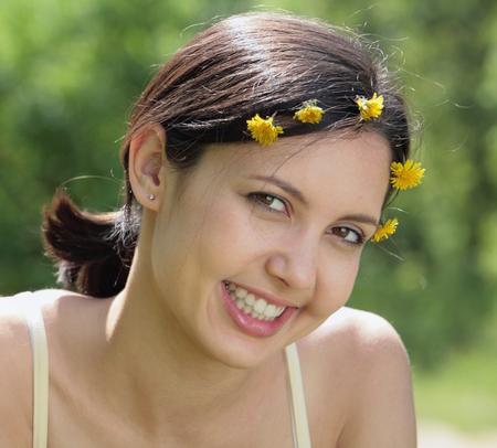 Portrait of smiling girl looking at camera in a natural environment photo