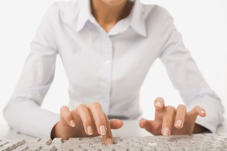 Close-up of businesswoman in white shirt doing some computer work Imagens