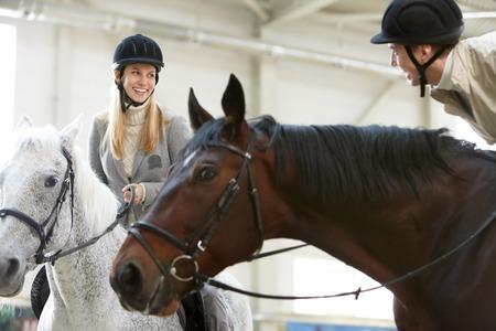 chestnut male: Image of couple enjoying horse training Stock Photo