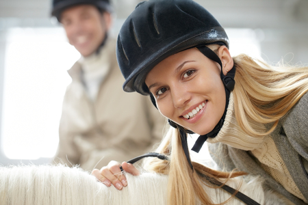 Face of a woman sitting on horseback