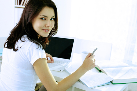 diligent: Student girl studying with laptop at home Stock Photo