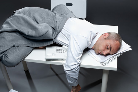 tired person: Office worker sleeping on his table