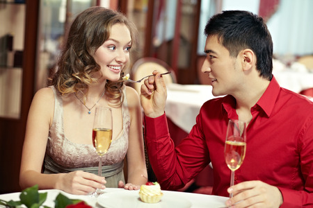 dining out: Young couple dining out at restaurant Stock Photo