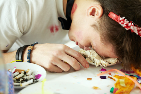 rowdy: Young man sleeping with his face in cake at his birthday