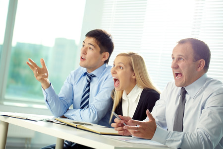 committee: Committee of three people shouting at a speaker