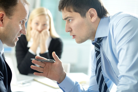 Young manager arguing with his boss at meeting Stock Photo