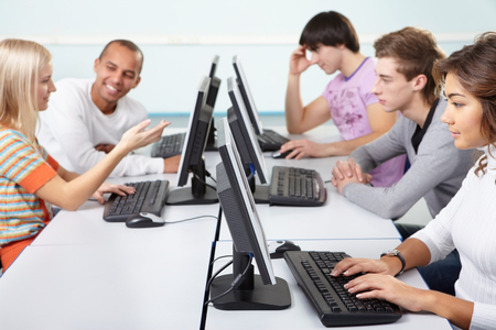 viewing: Five students are studying using computers