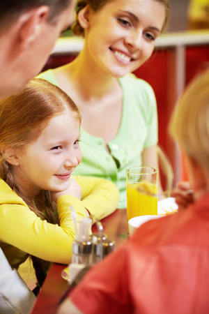 restaurant dining: A family dining in cafe, the focus is on the girl